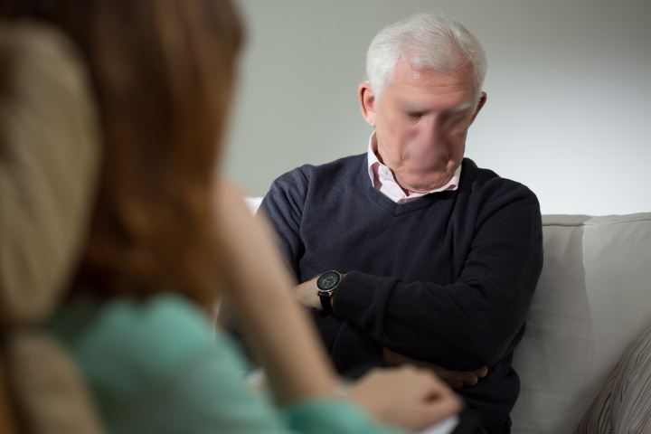Grey haired man in a counselling session